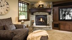 Dellwood, MN home shows off this custom designed and built fireplace and built in cabinetry