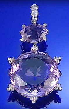 AMETHYST AND DIAMOND PENDANT, CIRCA 1880, THE LARGE CIRCULAR MIXED-CUT AMETHYST WITHIN A...