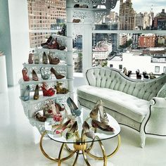 a spiral staircase for the sole purpose of displaying shoes... <3