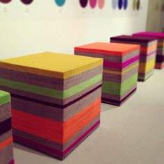 Felt stools (from Fitz felt) to sit or stand on. Might be cool to have blocks of color matching colors in dresses