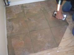 APPLYING GROUT TO CERAMIC TILE FLOOR   Http://www.homeadditionplus.com