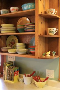 We see how a reader cleaned up and restored, decorated around their vintage knotty pine kitchen cabinets in their retro dream house. Kitchen Cabinets 1950s, Pine Kitchen Cabinets, Kitchen Shelves, Kitchen Redo, Kitchen Remodel, Corner Shelves, Window Shelves, 1950s Kitchen, Open Cabinets