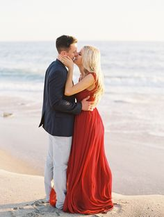 We love this red dress | Photography: Lane Dittoe - lanedittoe.com  Read More: http://www.stylemepretty.com/california-weddings/2015/03/10/romantic-laguna-beach-engagement/