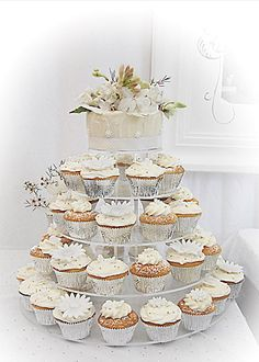 Tiny wedding cake (to cut & freeze) plus cupcakes for guests (no cutting or dishes to wash!)