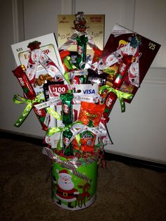 Christmas candy & gift card bouquet tin - for Spencer. December 2015. #candybouquet #christmasgift #christmastin #DIY #giftcardideas