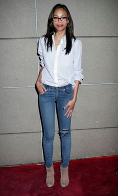 Zoe Saldana looks casual in vintage-washed skinny jeans and a white button-down.