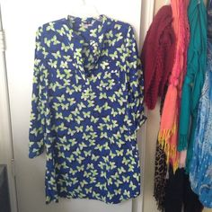 Gap Butterfly Shift Dress This  EUC cobalt blue dress is definitely a statement dress! The lime green and white butterfly's will catch the eyes of many whenever you walk in the door! The dress has two pockets and the sleeves can be rolled up or left as they are with buttons on the bottom of the sleeves to make it tight on the wrist. It also has 4 buttons at the top of the dress to either wear it high collared or to open up a bit :-) if you have any questions feel free to ask! 100% Polyester…