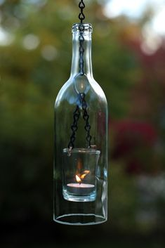 Wine/beer bottle candles. These are so pretty made with different color bottles. Can also use votive candles. Hang several from a tree for ambiance at night.