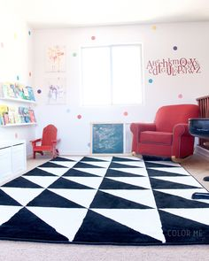 Colorful kids playroom with IKEA rug and shelves. Polka dot vinyl decals make this room amazing!