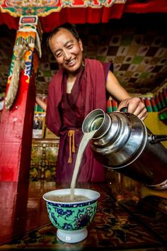 The Tibetan monk is giving himself a cup of butter tea.# http://www.tibet-tours.org/2017/06/top-six-tibetan-food-that-you-must-try.html