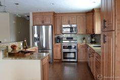 Mendota Maple Caramel Raised Panel Kitchen Cabinets from CliqStudios.com