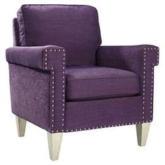 """Made in the USA, this plum-hued arm chair is wrapped in brushed cotton upholstery and highlighted with pewter-finished nailhead trim.  Product: ChairConstruction Material: Wood and fabricColor: PlumFeatures:  Square tapered legsLoose pillow backGreek key arms with nailhead trim detailing Dimensions: 36"""" H x 31.5"""" W x 32"""" D"""