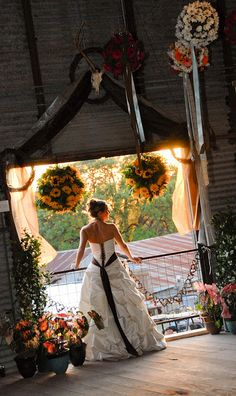 The sunflowers in balls hanging from ceiling  - like the idea of hanging ribbons in brides colors from some area ....Texas Hill Country Wedding by wilkinsonranch, via Flickr