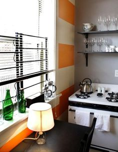 Love! this orange striped wall in the kitchen.