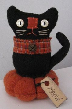 "Halloween Black Cat Pin Keep. Button eyes, homespun collar, rusty jingle bell, tufted cushion. Measures 5"" high."