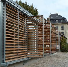 Shutter frames galvanized steel, equipped with horizontal teak wood louvers.