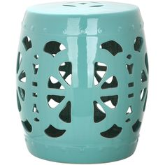 An over-scale pierced cutout creates a bold contemporary statement in the glazed ceramic Stencil Blossom garden stool in aqua.