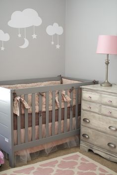 Pink and Gray Nursery  Crib is Babymod from Walmart Bedding is Cotton Tale Nightingale from BabiesRUs Cloud Decals from Etsy Rug from Land of Nod Dresser was a hand me down and has been refinished with white paint and gray wood stain  Pink crystal knobs from Top Knobs Pewter cup pulls from Top Knobs Lamp hand me down refinished with Pewter spray paint  Lamp Shade from Land of Nod