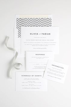 Gray modern wedding invitations with chevron details and a romantic script