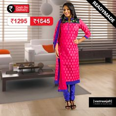 This magenta Banarasi kurta with mandarin collar, contrast embroidered panel at the chest and back. The mandarin collar is in royal blue and has royal blue piping around the neckline. The hemline and the 3/4th sleeves hem has a taping of royal blue fabric. The woven bottom in poly silk is in royal blue and the 2 toned dupatta has embroidery all over.  Visit www.vastraanjali.com for online shopping