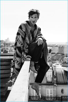 Gaspard Ulliel wears a striking poncho from Valentino for L'Express Styles.