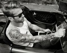Arm tattoo,haircut,sunglasses,vintage car,sexy man!there is nothing wrong with this photo!picture perfect!