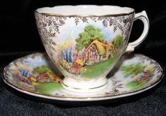 English thatched roof cottage on cup and saucer