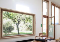 Pale wooden window frames contrast with the black stained cedar facades of this extension to a detached house in Nantes by Bertin Bichet Architectes. Timber Windows, Wooden Windows, Windows And Doors, Front Doors, Facade Design, House Design, Wooden Window Frames, Wood Facade, House Extensions
