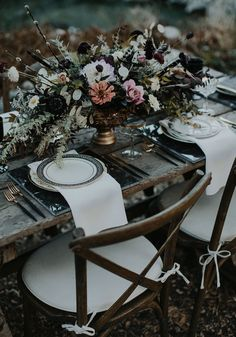Haunted Harvest Inspiration // dark and moody tablescape with rustic touches // old world gold floral vase and marble charger placemats