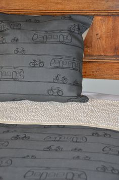 cot quilt screen printed in trams and bikes design on organic grey blue cotton/ linen fabric and white dashes print. $125.00, via Etsy.