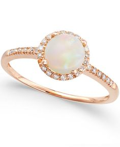 Magical shine. Indulge in this sophisticated piece, featuring round-cut opal (3/4 ct. t.w.) surrounded by sparkling diamonds (1/8 ct. t.w.). Ring set in 14k rose gold. | Photo may have been enlarged a