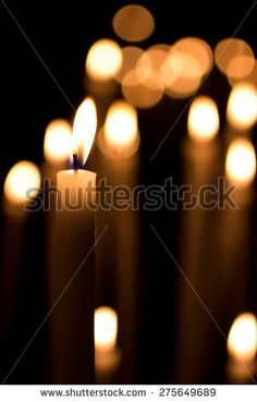 closeup of a #burning #candle on a dark background with soft #lighting #microstockita