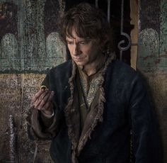 "Martin Freeman, avoiding much of the battle as Bilbo Baggins in ""The Hobbit: The Battle of the Five ... - Warner Bros. Pictures"