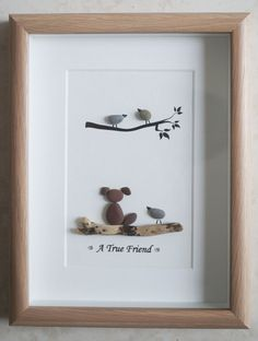 This is a beautiful small Pebble Art framed Picture of a Dog & Bird - A true Friend handmade by myself using Pebbles, Driftwood and Wooden Heart Size of Picture incl Frame : approx. 22cm x 17cm Thanks for looking Doris Facebook: https://facebook.com/Pebbleartbyjewlls4u Product Code: P - Orange