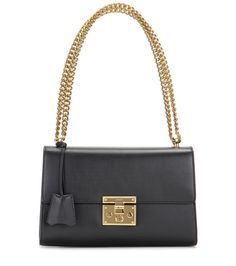 Gucci - Padlock leather shoulder bag - Opt for opulence with Gucci's 'Padlock' shoulder bag. With incredibly smooth black calfskin coating the structured silhouette, it promises to stand the test of time. We adore the gold-tone hardware that gives a distinctly glamorous finish. Carry it from the office to a dinner date next to a pencil skirt and cashmere sweater. seen @ www.mytheresa.com