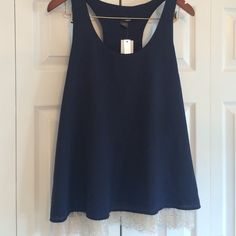 Aqua Navy Blue Razorback tank with lace detail Brand new navy blue tank with lace around the bottom. Runs long- perfect with jeans or leggings for a night out. Purchased from Bloomingdales. Aqua Tops Camisoles