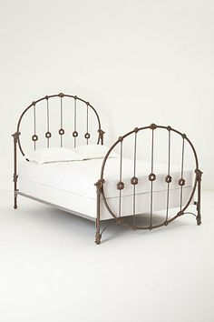 I wish I were a little girl again so I could have this lovely little bed. Hoopskirt Bed Frame #anthropologie