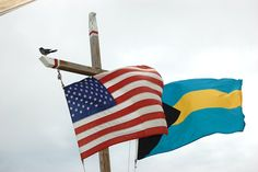 Blowing in the wind together...American and Bahamian flags