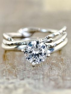 "An interesting ""twist"" on a solitaire style engagement ring. Exquisite does custom work, learn more at http://exquisite.ca/Custom.html"