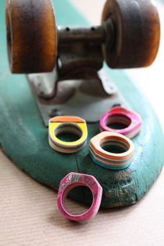 rings made out of recycled skateboards. by sevenply