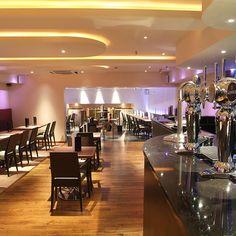 Bar and seating area, contemporary lighting, Jags Bar, Devon, England