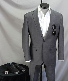 With a mid-gray suit | How to wear it: Sleek Penny Loafers in Summer on Dappered.com