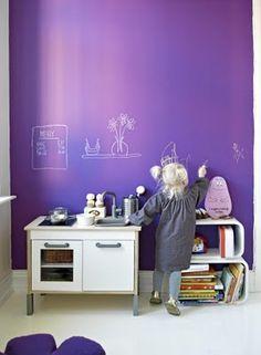 A purple chalkboard wall