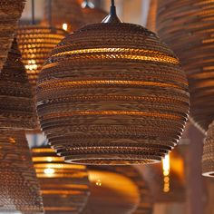 The Sun Pendant Lamp (Graypants GP201) is the ultimate in style and simplicity, created from laser cut corrugated cardboard this light offers a beautiful array of light that seeps