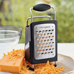 I love the Microplane Box Grater.  It washes up so great in the dishwasher.
