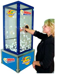 Mini money blowing booth.  Anyone can do this! Reach in - pull out a ping pong ball with prize written on it.  Easy Breezy - sits on table top.