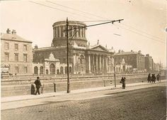 A view across the River Liffey at the James Gandon designed Four Courts. Ireland Pictures, Old Pictures, Old Photos, Dublin Map, Dublin Ireland, Dublin Street, Photo Engraving, National Archives, Law And Order