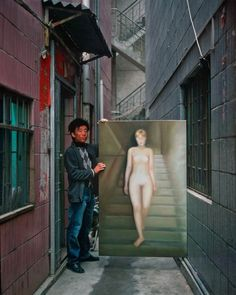 """Between 2005 and Michael Wolf photographed painters in Shenzhen, China, who reproduced famous works of art. Each portrait consisted of a """"copy artist"""". Wolf Photography, Artistic Photography, Keep Calm And Smile, Michael Wolf, Eclectic Artwork, Portraits, Famous Words, Urban Life, Weird World"""