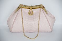 Pastel pink python with an enamel and beaded French frame from the 20s