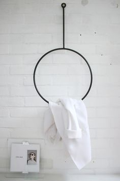 round clothing rack + improvised picture frame  (rack> http://annaleena.se/shop ) --that circle hanging rack is wonderful